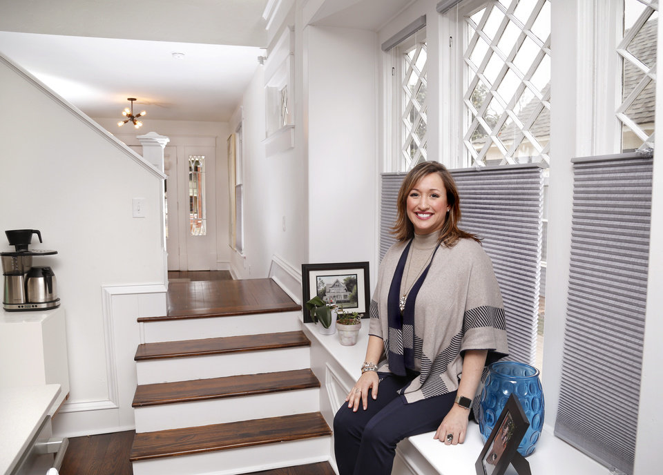 Photo -  Jennifer Arsenault, 2018 president of the Oklahoma City Metro Association of Realtors, sits in a 1910 home she has listed for sale for $565,000 at 812 NW 19. [PHOTO BY JIM BECKEL, THE OKLAHOMAN]