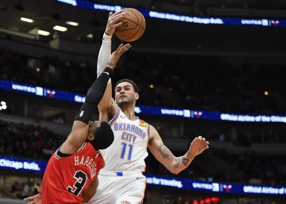 Photo -  Oklahoma City's Abdel Nader (11) blocks the shot of Chicago's Shaquille Harrison during Tuesday night's game at United Center. OKC beat the Bulls 124-122. [Quinn Harris/USA TODAY Sports]