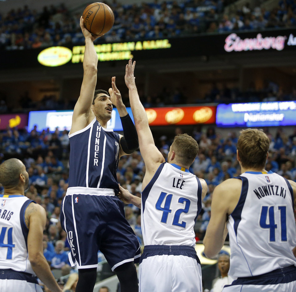 Photo - Oklahoma City's Enes Kanter (11) shoots over Dallas' David Lee (42) during Game 3 of the first round series between the Oklahoma City Thunder and the Dallas Mavericks in the NBA playoffs at American Airlines Center in Dallas, Thursday, April 21, 2016. Photo by Bryan Terry, The Oklahoman
