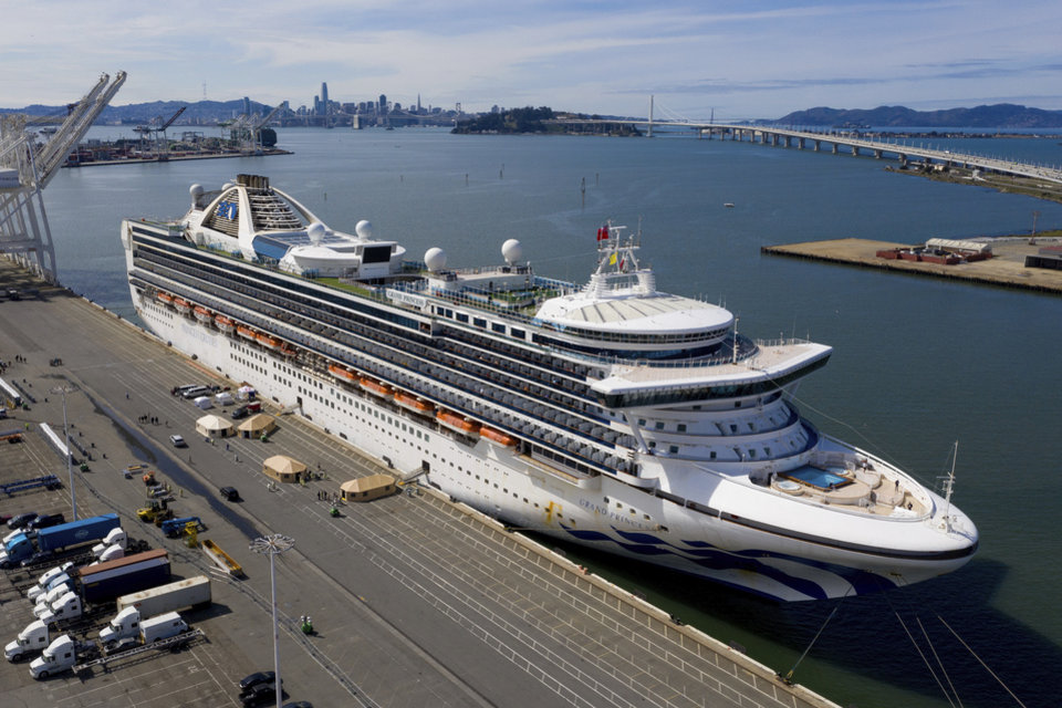 Photo - Tents stand on a wharf near the Grand Princess at the Port of Oakland in Oakland, Calif., Monday, March 9, 2020. The cruise ship, which had maintained a holding pattern off the coast for days, is carrying multiple people who tested positive  for COVID-19, a disease caused by the new coronavirus. (AP Photo/Noah Berger)