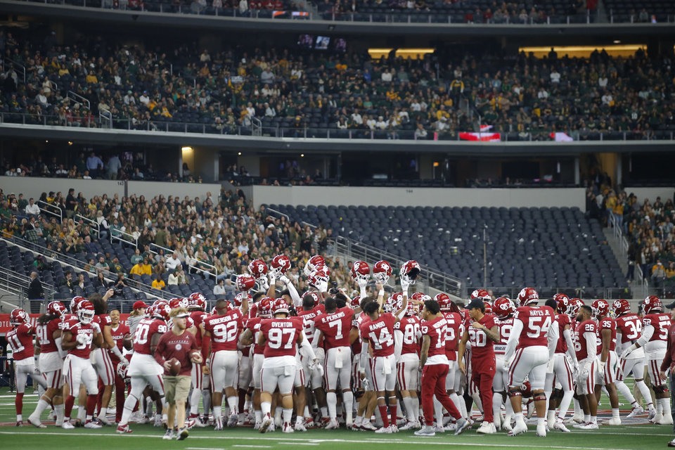 Photo - Oklahoma gathers before the Big 12 Championship Game between the University of Oklahoma Sooners (OU) and the Baylor University Bears at AT&T Stadium in Arlington, Texas, Saturday, Dec. 7, 2019. [Bryan Terry/The Oklahoman]
