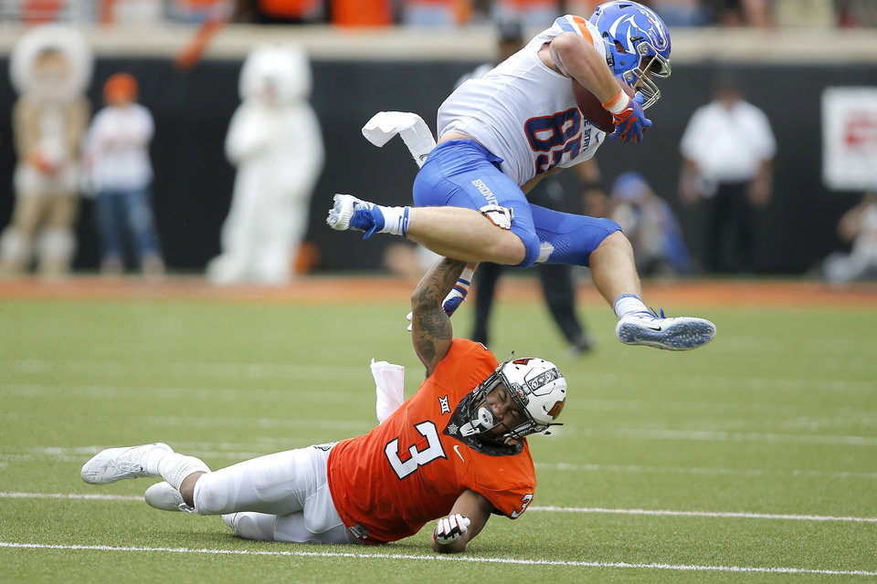 Photo - Oklahoma State's Kenneth Edison-McGruder (3) tries to bring down Boise State's John Bates (85) during a college football game between the Oklahoma State University Cowboys (OSU) and the Boise State Broncos at Boone Pickens Stadium in Stillwater, Okla., Saturday, Sept. 15, 2018. Oklahoma State won 44-21. Photo by Bryan Terry, The Oklahoman