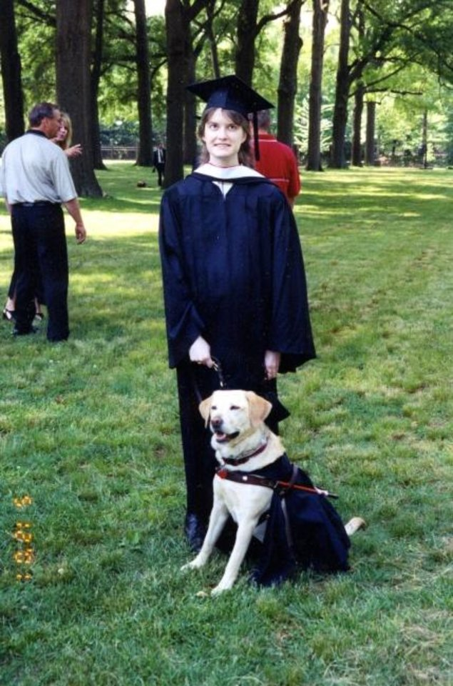 Photo -  Leah Campbell at her 1995 Rhodes College graduation with her guide dog, Precious. [Photo provided]