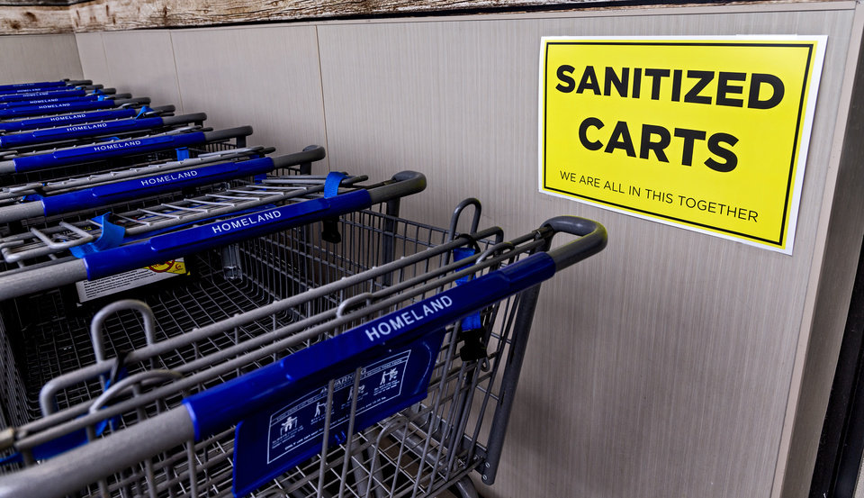 Photo - Sanitized carts available for customers to use while shopping in the Homeland located at 1108 NW 18th St. in Oklahoma City, Okla. on Monday, April 13, 2020. The store has taken extra steps to help protect its employees and customers during the coronavirus pandemic.   [Chris Landsberger/The Oklahoman]