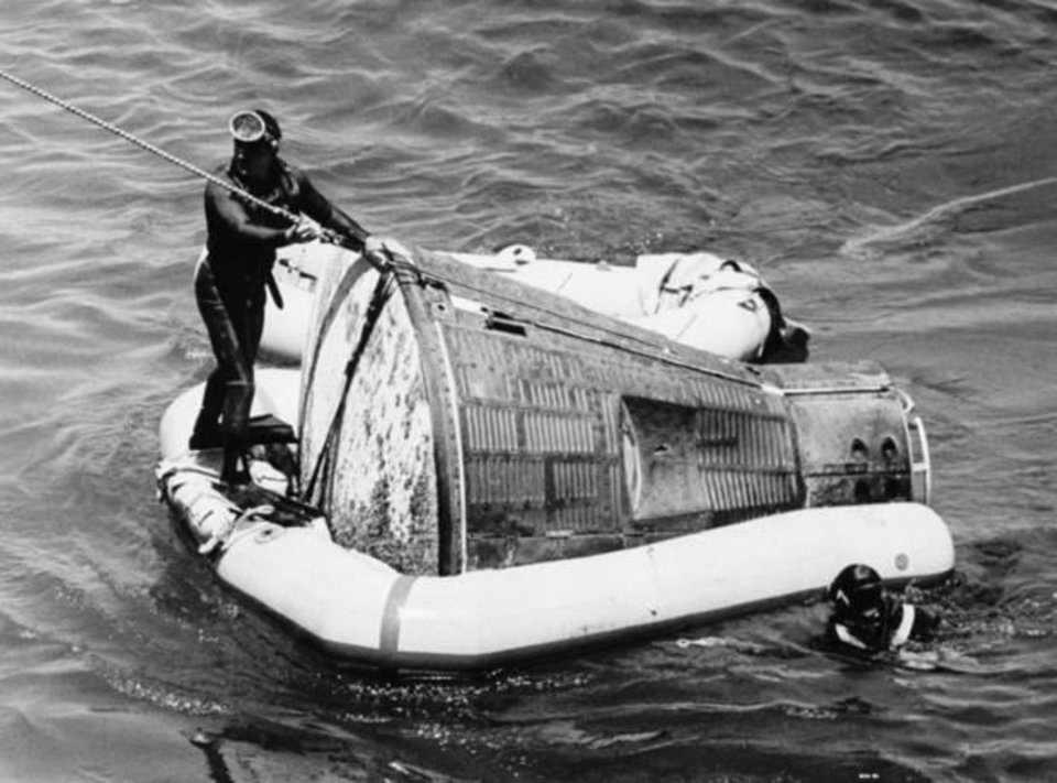 Photo - U.S. Navy divers recover the Gemini 5 spacecraft and astronauts Gordon Cooper and Charles Conrad, who orbited the earth for nearly eight days, from the Atlantic Ocean, in this Aug. 29, 1965. AP Photo