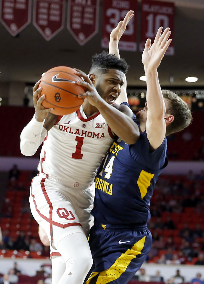 Photo - Oklahoma's Rashard Odomes (1) tries to get past West Virginia's Chase Harler (14) during an NCAA college basketball game between the University of Oklahoma (OU) and West Virginia at Lloyd Noble Arena in Norman, Okla.,  Saturday, March 2, 2019. Photo by Bryan Terry, The Oklahoman
