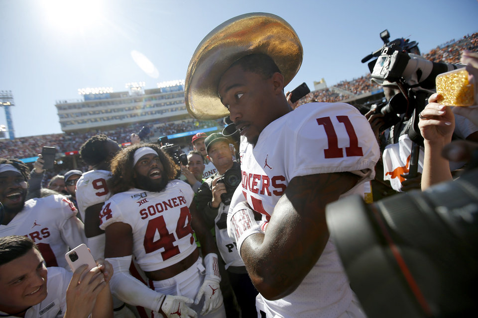 Photo - Oklahoma's Parnell Motley (11) wears the Golden Hat after the Red River Showdown college football game between the University of Oklahoma Sooners (OU) and the Texas Longhorns (UT) at Cotton Bowl Stadium in Dallas, Saturday, Oct. 12, 2019. Oklahoma won 34-27. [Bryan Terry/The Oklahoman]