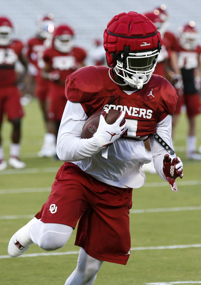 Photo - OU's Trey Sermon (4) runs after a catch during football practice for the University of Oklahoma Sooners at Gaylord Family - Oklahoma Memorial Stadium in Norman, Okla., Monday, Aug. 12, 2019. [Nate Billings/The Oklahoman]