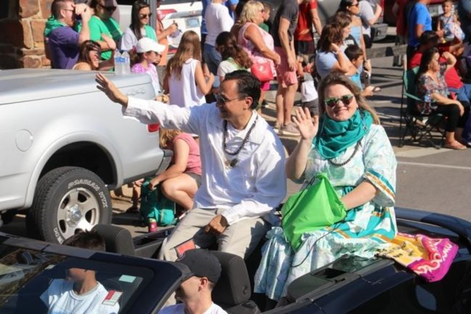Photo -  Then-Cherokee Nation Principal Chief-elect and former Secretary of State Chuck Hoskin Jr. rides with wife, January Hoskin, in the Cherokee National Holiday parade in 2018. Hoskin will deliver his first State of the Nation address as principal chief at the 67th Annual Cherokee National Holiday on Saturday. [Photo provided]