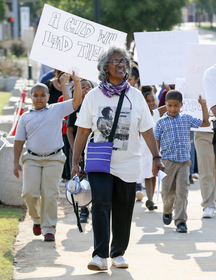 Photo - Joyce Henderson, a participant in the Katz Drug Store sit-ins, leads a march along NW 10 from Frontline Church to Kaiser's Grateful Bean to commemorate the 60th anniversary of the Katz Drug Store sit-ins, some of the first civil rights protests in the nation, in Oklahoma City, Saturday, Aug. 18, 2018. The first Katz Drug Store sit-in happened on August 19, 1958. Photo by Nate Billings, The Oklahoman
