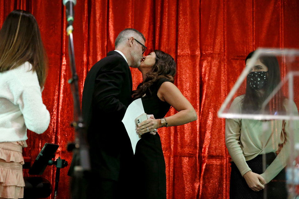 Photo - Stephanie Bice kisses her husband Geoffrey Bice during a Republican Party election night watch party in Edmond, Okla., after winning the 5th District Congressional seat, Tuesday, Nov. 3, 2020. [Bryan Terry/The Oklahoman]