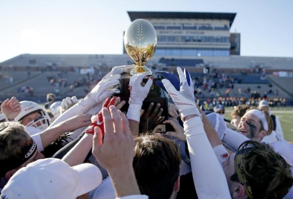 Photo -  Metro Christian celebrates the 2A during the Class 2A state championship football game over Washington at Wantland Stadium in Edmond, Okla.,  Saturday, Dec. 19, 2020. [Sarah Phipps/The Oklahoman]
