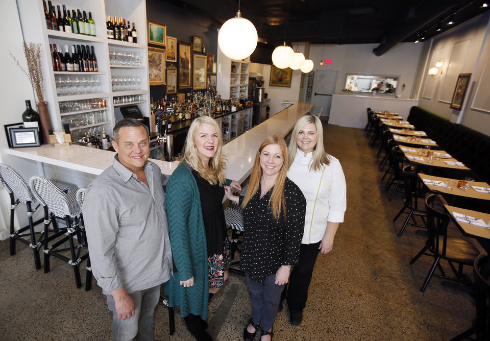 Photo -  From left, Plaza developers Steve Mason and Aimee Ahpeatone visit with Mindy Magers and Shleby Sieg, manager and chef at The Pritchard Wine Bar, 1749 NW 16. [Photo by Nate Billings, The Oklahoman]