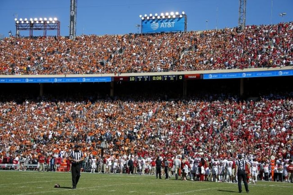 Photo -  A full crowd at Cotton Bowl Stadium watches OU's 34-27 win over Texas in last year's Red River Showdown in Dallas. [Bryan Terry/The Oklahoman]