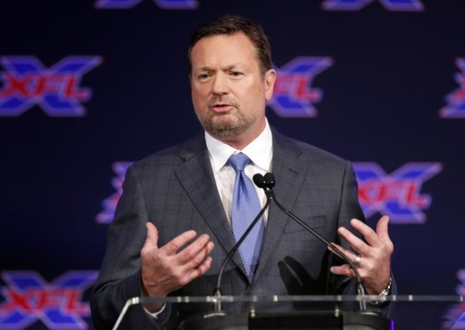 Photo -  Bob Stoops will make his return to the coaching sidelines next February with the XFL's Dallas franchise. [AP Photo/Tony Gutierrez]