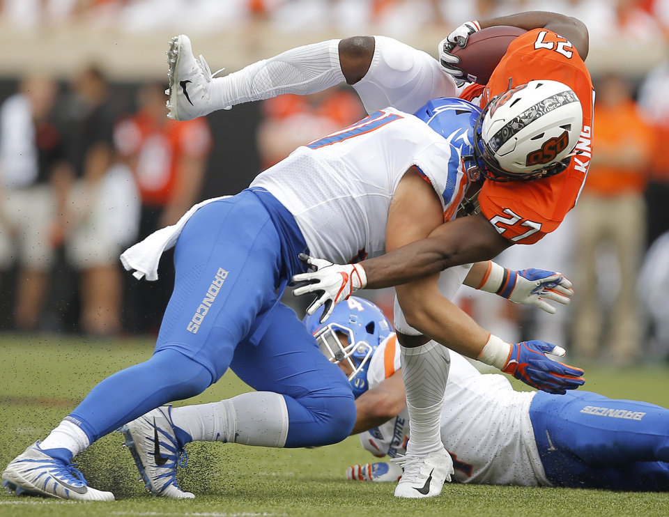 Photo - Oklahoma State's J.D. King (27) is hit by Boise State's Durrant Miles (91) during a college football game between the Oklahoma State University Cowboys (OSU) and the Boise State Broncos at Boone Pickens Stadium in Stillwater, Okla., Saturday, Sept. 15, 2018. Oklahoma State won 44-21. Photo by Bryan Terry, The Oklahoman