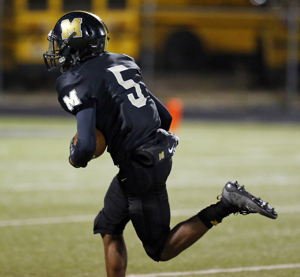 Photo - Midwest City's Brian Wilson Jr. (5) takes a catch for a long touchdown in the second quarter during a high school football game between Midwest City and Choctaw at Rose Field in Midwest City, Okla., Friday, Nov. 1, 2019. [Nate Billings/The Oklahoman]