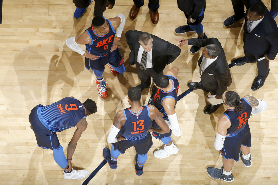 Photo - Oklahoma City coach Billy DOnovan gathers his team during an NBA basketball game between the Oklahoma City Thunder and the Detroit Pistons at Chesapeake Energy Arena in Oklahoma City, Friday, Nov. 24, 2017. The Pistons won 99-98. Photo by Bryan Terry, The Oklahoman