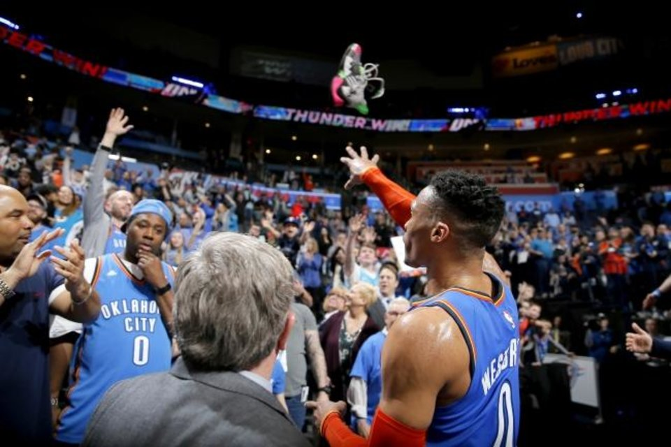 Photo -  Oklahoma City's Russell Westbrook (0) throws his shoe to a fan after an NBA basketball game between the Oklahoma City Thunder and the Brooklyn Nets at Chesapeake Energy Arena in Oklahoma City, Wednesday, March 13, 2019. Oklahoma City won 108-96. Photo by Bryan Terry, The Oklahoman