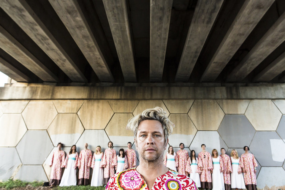Photo -  Tim DeLaughter, center, is shown alongside the Polyphonic Spree. The Dallas-based indie rock band headlined the first Norman Music Festival and the frontman fondly remembered the performance. [Photo provided by Lauren Logan]