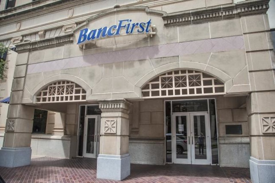 Photo -  The BancFirst building located in downtown Oklahoma City is shown in this file photo. While Bancfirst lobbies have remained open, others have gone to drive-thru only. Data also shows the number of mobile banking users has increased since the pandemic began. [THE OKLAHOMAN ARCHIVES]