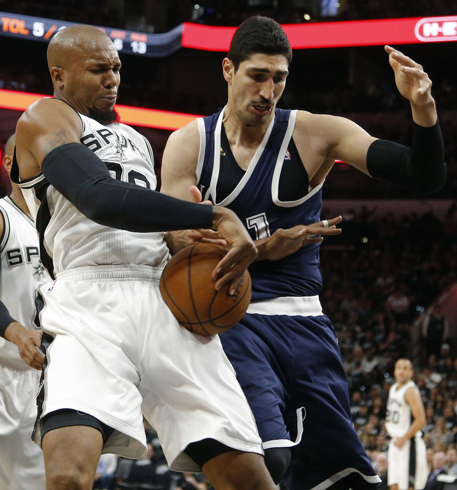 Photo - San Antonio's David West (30) fights for the ball with Oklahoma City's Enes Kanter (11) during Game 1 of the second-round series between the Oklahoma City Thunder and the San Antonio Spurs in the NBA playoffs at the AT&T Center in San Antonio, Saturday, April 30, 2016. San Antonio won 124-92. Photo by Bryan Terry, The Oklahoman