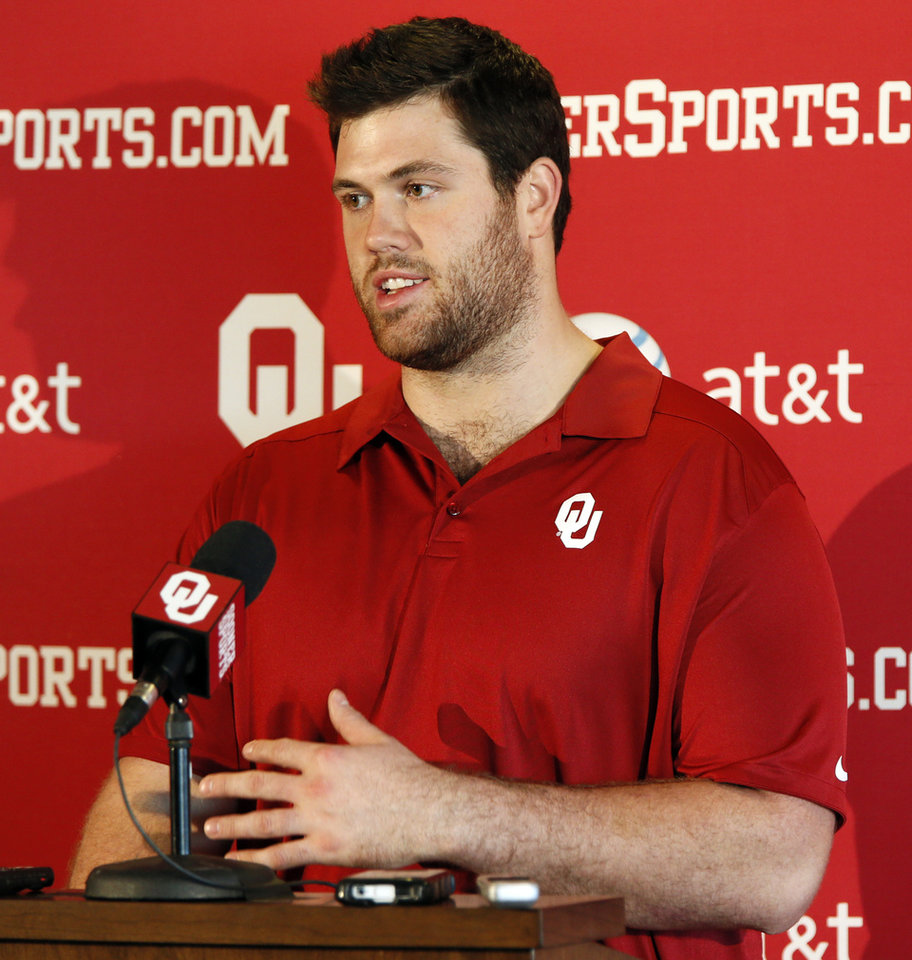 Photo - OU's Gabe Ikard speaks during a press conference for the Oklahoma Sooners football team in the Chesapeake Stadium Club at Gaylord Family - Oklahoma Memorial Stadium in Norman, Okla., Monday, Dec. 16, 2013. OU will play Alabama in the Sugar Bowl on January 2, 2014. Photo by Nate Billings, The Oklahoman