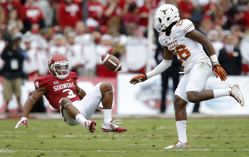 Photo - Texas' Adrian Colbert (26) draws a flag as he hits Oklahoma's Sterling Shepard (3) before he could catch a punt during the Red River Showdown college football game between the University of Oklahoma Sooners (OU) and the University of Texas Longhorns (UT) at the Cotton Bowl in Dallas on Saturday, Oct. 11, 2014. 