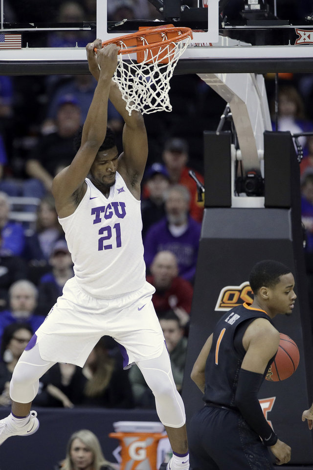 Photo - TCU's Kevin Samuel gets past Oklahoma State's Curtis Jones for adunk during the first half of an NCAA college basketball game in the Big 12 men's tournament Wednesday, March 13, 2019, in Kansas City, Mo. (AP Photo/Charlie Riedel)