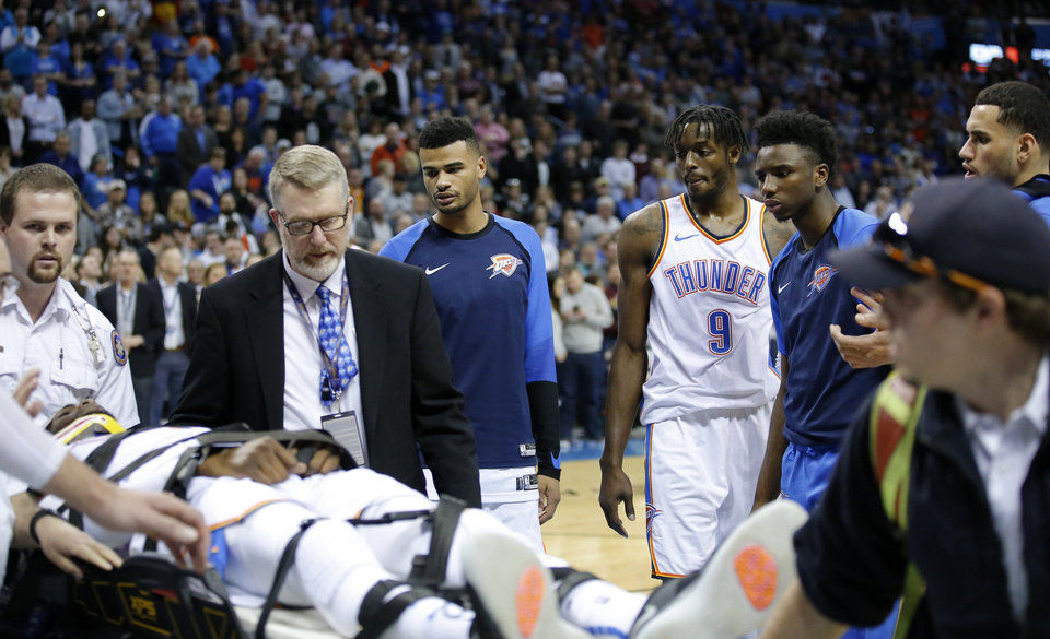 Photo - The Thunder watch as Oklahoma City's Nerlens Noel (3) is taken off the court is during the NBA game between the Oklahoma City Thunder and Minnesota Timberwolves at the Chesapeake Energy Arena, Tuesday, Jan. 8, 2019. Photo by Sarah Phipps, The Oklahoman