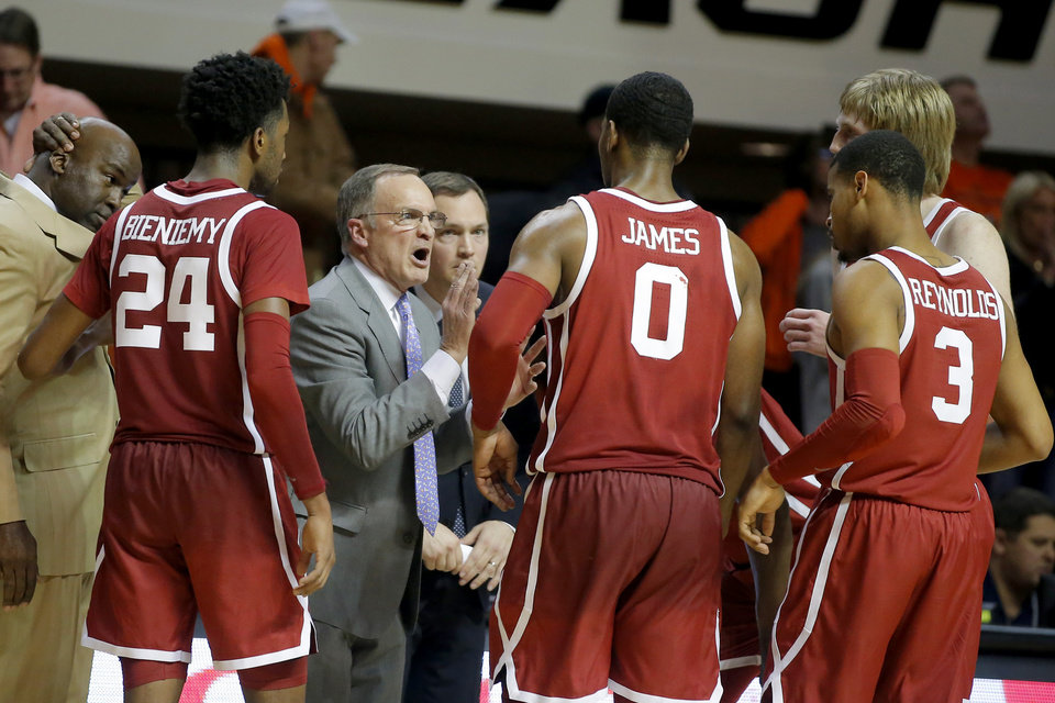 Photo - Oklahoma coach Lon Kruger talks with Oklahoma's Jamal Bieniemy (24), Christian James (0) and Miles Reynolds (3) during a Bedlam basketball game between the Oklahoma State Cowboys (OSU) and the University of Oklahoma Sooners (OU) at Gallagher-Iba Arena in Stillwater, Okla., Wednesday, Jan. 23, 2019. Oklahoma won70-61. Photo by Bryan Terry, The Oklahoman