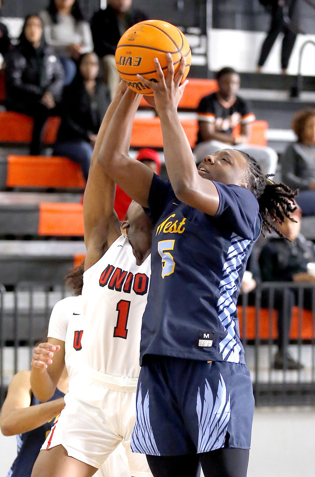 Photo - Putnam City West's Sharonica Hartsfield goes to the basket Union's Darian Carr during the girls championship game between Putnam City West and Tulsa Union at the Putnam City Invitational at Putnam City High School in Oklahoma City, Okla.,  Saturday, Jan. 11, 2020.  [Sarah Phipps/The Oklahoman]