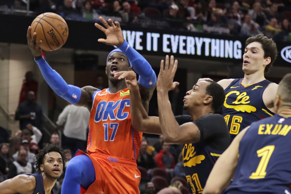 Photo - Oklahoma City Thunder's Dennis Schroder (17) drives against Cleveland Cavaliers' John Henson (31) in the second half of an NBA basketball game, Saturday, Jan. 4, 2020, in Cleveland. Oklahoma won 121-106. [AP Photo/Tony Dejak]
