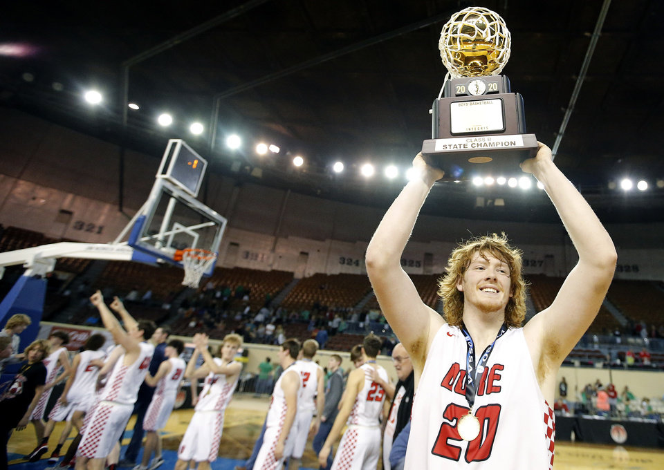 "Photo - Duke's Jameson Richardson (20) celebrates with the trophy following the Class B boys basketball tournament championship game between Duke and Leedey inside Jim Norick Arena, ""The Big House,"" at the OKC Fairgrounds in Oklahoma City,  Saturday, March 7, 2020. [Sarah Phipps/The Oklahoman]"
