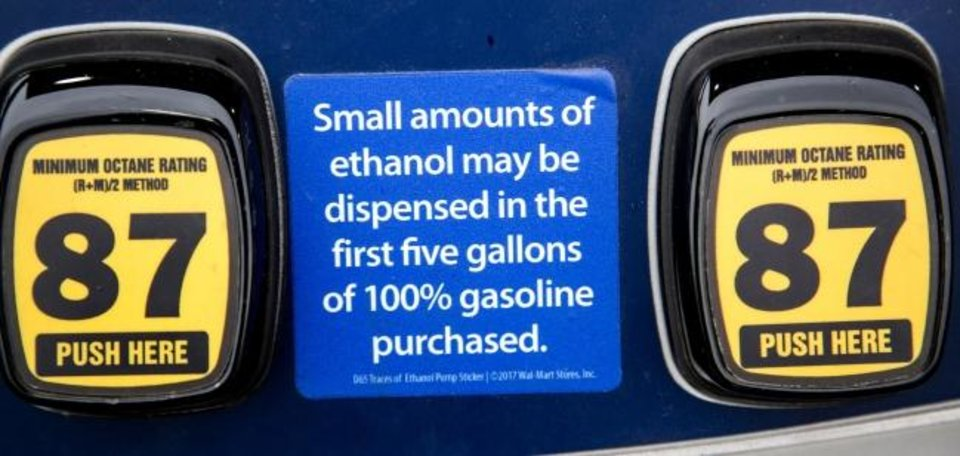 Photo -  Retailers in Oklahoma are required to post notices that trace amounts of ethanol could remain in hoses for pumps used for both blended and straight gasoline. [CHRIS LANDSBERGER/THE OKLAHOMAN]