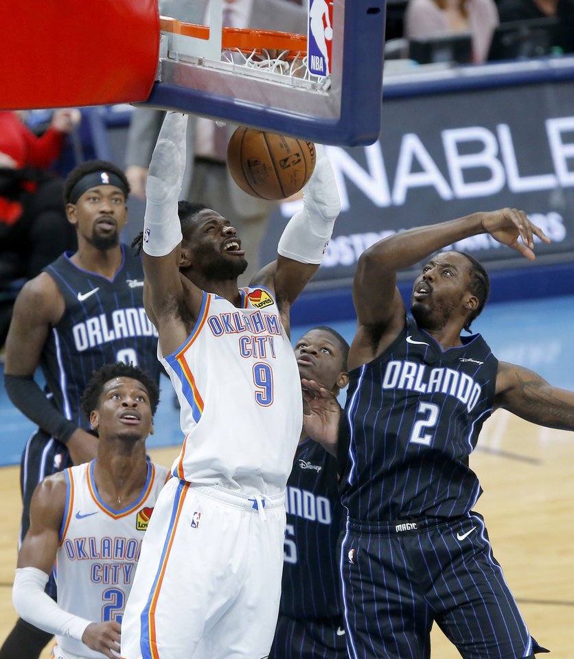 Photo - Oklahoma City's Nerlens Noel (9) dunks beside Orlando's Al-Farouq Aminu (2) and Mo Bamba (5) during an NBA basketball game between the Oklahoma City Thunder and the Orlando Magic at Chesapeake Energy Arena in Oklahoma City, Tuesday, Nov. 5, 2019. Oklahoma City won 102-94. [Bryan Terry/The Oklahoman]