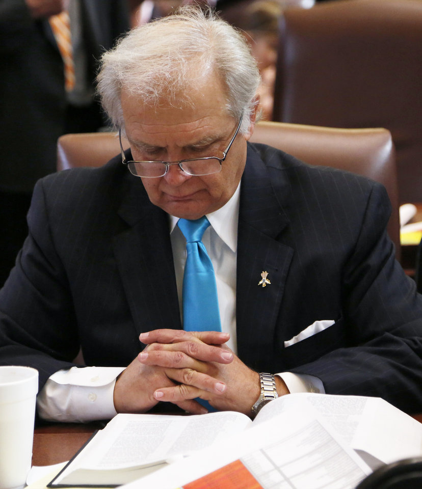 Photo - Rep. Richard Morrissette reads over paperwork before the start of the Oklahoma Legislature's 2016 State-of-the-State Address by Gov. Mary Fallin in the chamber of the House of Representatives at the Oklahoma state capitol on Monday, Feb. 1, 2016, in Oklahoma City, Okla. Photo by Jim Beckel, The Oklahoman