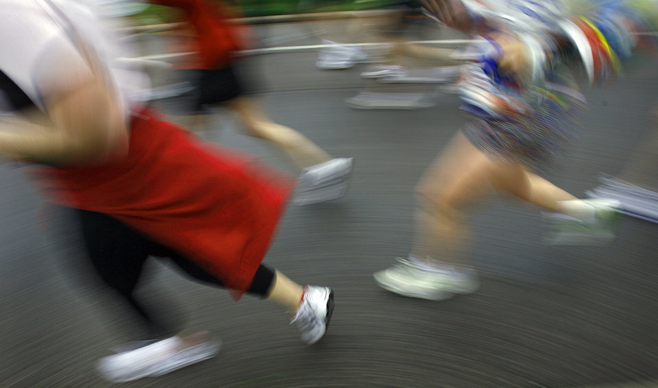 Photo - RUN, RUNNING: Marathon runners are a blur motion as they run down Classen Avenue during the eighth annual Oklahoma City Memorial Marathon on Sunday , April 27, 2008, in Oklahoma City, Okla.   PHOTO BY CHRIS LANDSBERGER   ORG XMIT: KOD