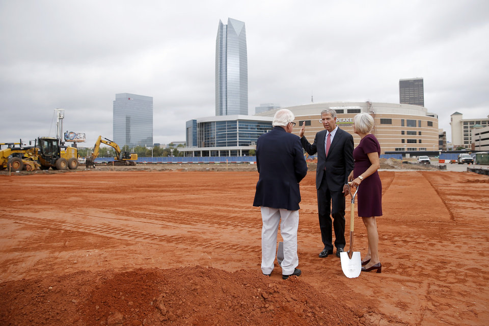 Photo -  Omni Hotels & Resorts founder Robert Rowling, center, speaks with Jim Tolbert, Urban Renewal Commissioner, and Cathy O'Connor, president of the Alliance for Economic Development of Oklahoma City, during a groundbreaking ceremony Monday for the 17-story, 605-room Omni hotel in Oklahoma City. [Photo by Bryan Terry, The Oklahoman]