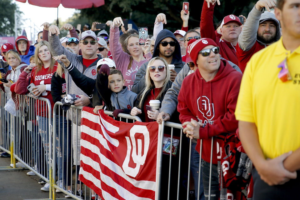 Photo - Oklahoma fans cheer as OU arrives before the Red River Showdown college football game between the University of Oklahoma Sooners (OU) and the Texas Longhorns (UT) at Cotton Bowl Stadium in Dallas, Saturday, Oct. 12, 2019. [Bryan Terry/The Oklahoman]