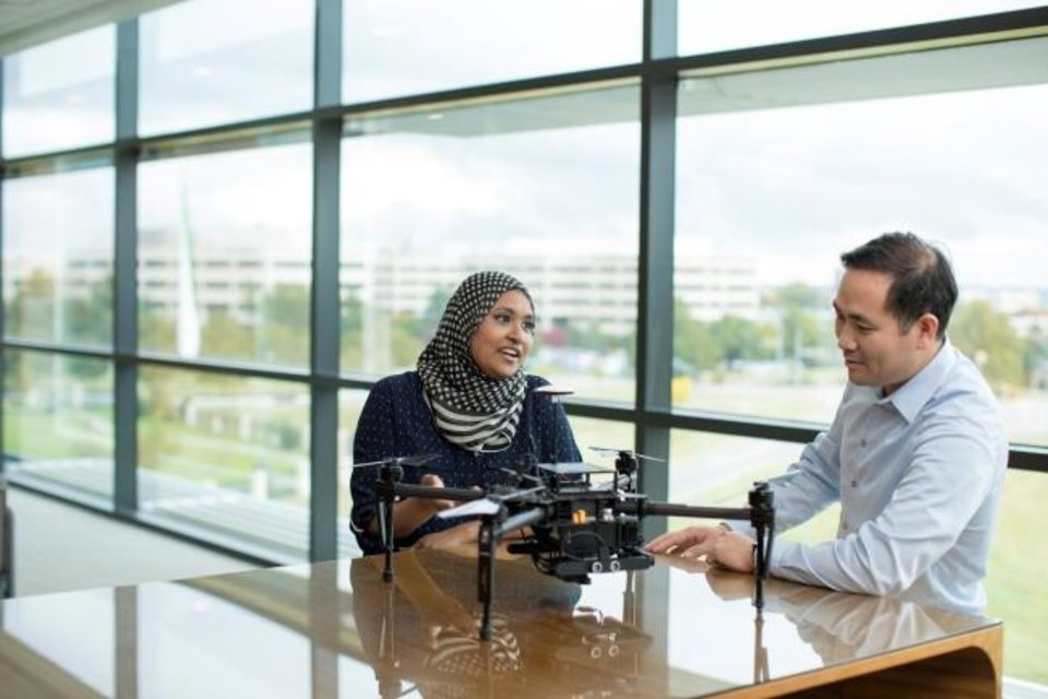 Photo -  Researchers at the Baker Hughes Energy Innovation Center collaborate on new technology to help reduce emissions through drones. [PROVIDED BY BAKER HUGHES]