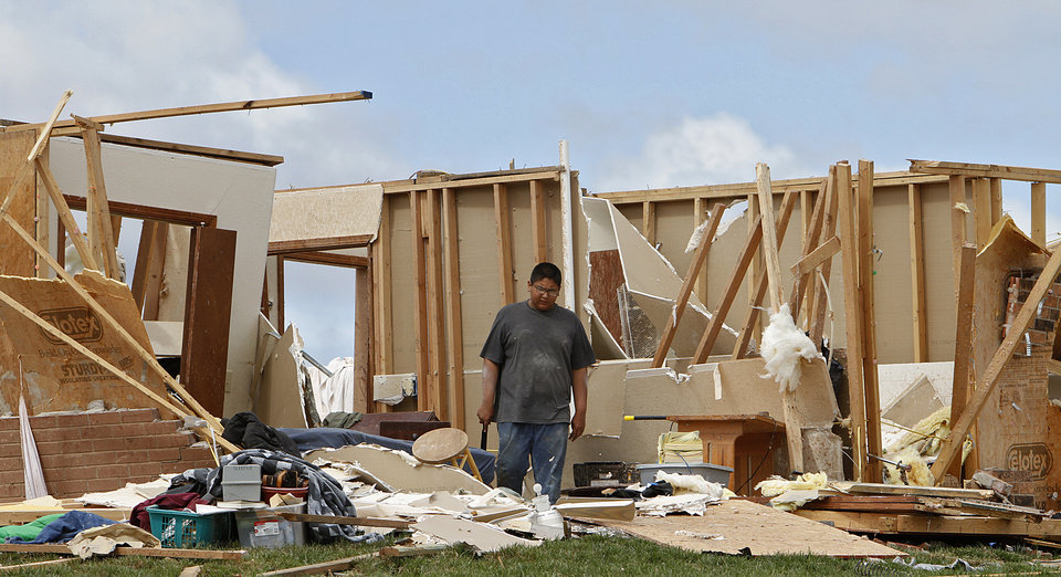 Photo - Charles Sleeper stands in what was his bedroom after it was destroyed by Tuesday's tornado west of El Reno, Wednesday, May 25, 2011. Photo by Chris Landsberger, The Oklahoman
