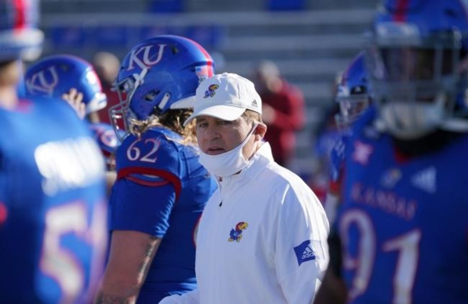Photo -  Coronavirus cases are spiking around the country, and while several FBS head coaches have tested positive — including Kansas coach Les Miles — it sure seems likely there will be more at home instead of on the sideline before the season is done. [Denny Medley/USA TODAY Sports]