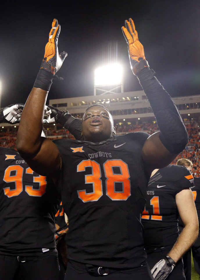 Photo - Oklahoma State's Emmanuel Ogbah (38) celebrates following the college football game between the Oklahoma State Cowboys (OSU) and TCU Horned Frogs at Boone Pickens Stadium in Stillwater, Okla., Saturday, Nov. 7, 2015. Photo by Sarah Phipps, The Oklahoman