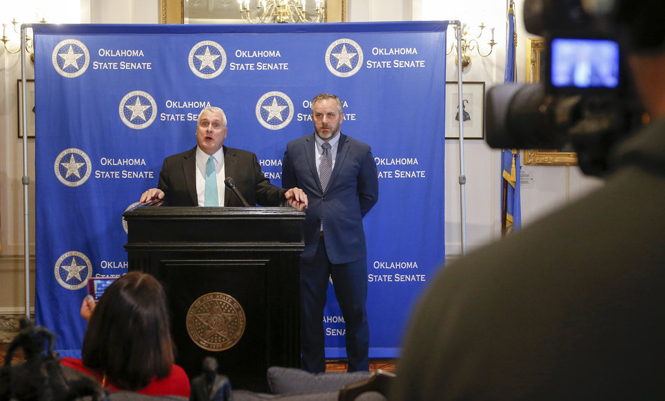 Photo - State Sen. Mike Schulz, left, R-Altus, President Pro Tempore of the Senate, speaks next to Sen. Greg Treat, R-Oklahoma City, Senate Majority Floor Leader, during a press conference on the fifth day of a walkout by Oklahoma teachers at the state Capitol in Oklahoma City, Friday, April 6, 2018. Photo by Nate Billings, The Oklahoman