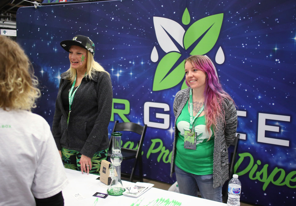 Photo - Marissa Jimenez, left, and Amanda Huffman at Mr. Green Dispensary booth at the Green Grow Expo at State Fair Park, Saturday, March 2, 2019.  Photo by Doug Hoke, The Oklahoman