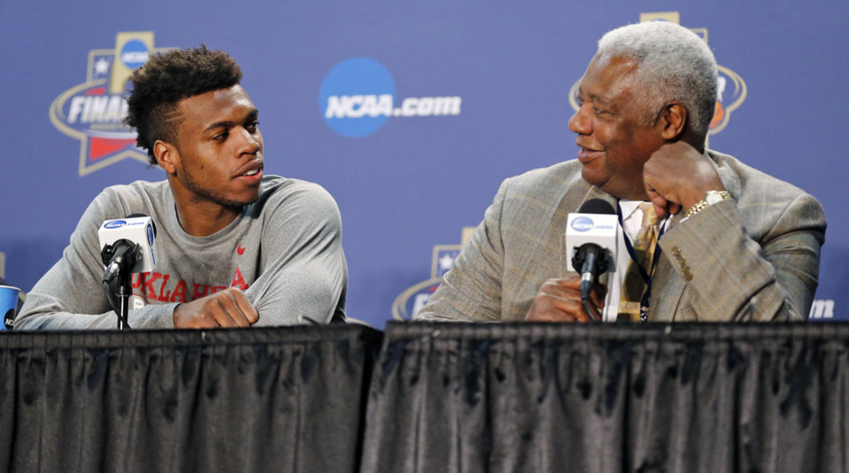 Photo - Oklahoma's Buddy Hield (24), left, and Oscar Robertson talk during the announcement that Hield won the U.S. Basketball Writers Association's Oscar Robertson Trophy at Final Four Friday before the national semifinal between the Oklahoma Sooners and the Villanova Wildcats in the NCAA Men's Basketball Championship at NRG Stadium in Houston, Friday, April 1, 2016. OU will play Villanova in the Final Four on Saturday. Photo by Nate Billings, The Oklahoman