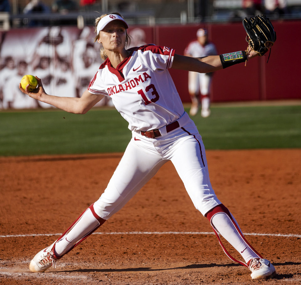 Photo - Oklahoma's Macy McAdoo (13) throws a pitch during the college softball game between the University of Oklahoma Sooners (OU) and Northwester University Wildcats (NU) at Marita Hynes Field in Norman, Okla. on Friday, Feb. 28, 2020.    [Chris Landsberger/The Oklahoman]