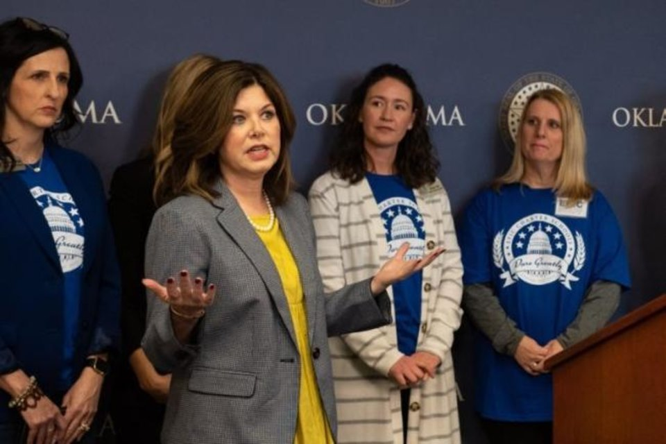 Photo -  Shelly Hickman, a spokeswoman for Epic Charter School, speaks to the media in March. [Whitney Bryen/Oklahoma Watch]
