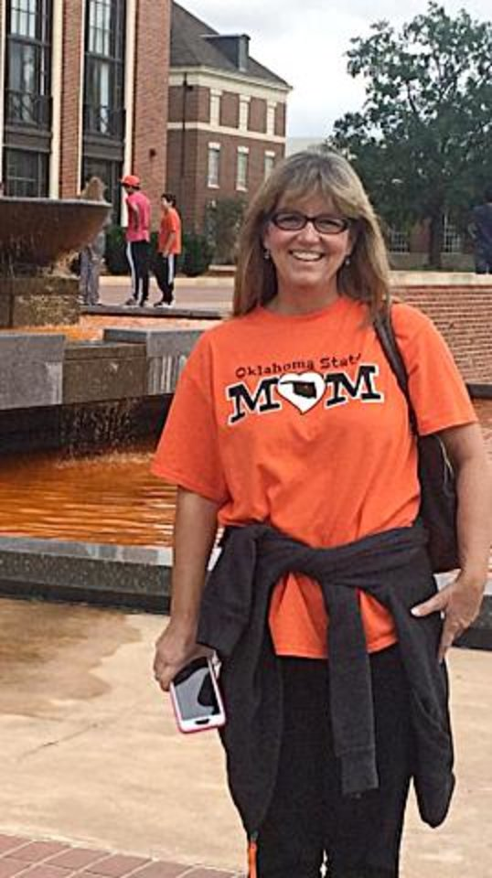 Photo - Mary Cardinal poses for a photo. Her daughter, Amanda, is a freshman at Oklahoma State University. Mary Cardinal was injured by the crash at OSU's homecoming parade. [Photo submitted]